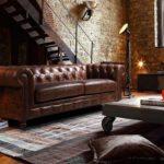 Phòng khách chung cư nên chọn sofa da hay sofa vải