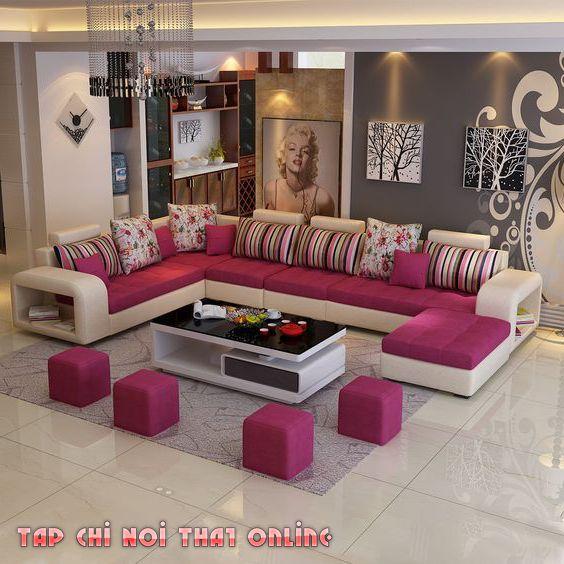 Phòng khách với gam màu chủ đạo hồng, đỏ cho gia chủ mệnh Hỏa.